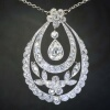 Edwardian pear diamond solitaire pendant, flowery design