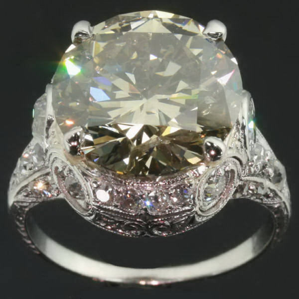 Extravagant estate engagement ring with one 6 crt bulky stone