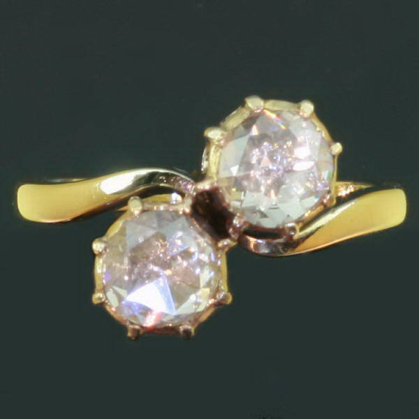 Antique diamond two stone crossover engagement ring yellow gold