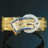 Vintage belt shaped gold bangle sapphire diamond setting