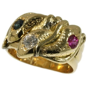 Gold snake ring with three entangled serpents with ruby, sapphire and brilliant