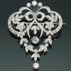 Elegant platinum brooch and pendant in Garland style
