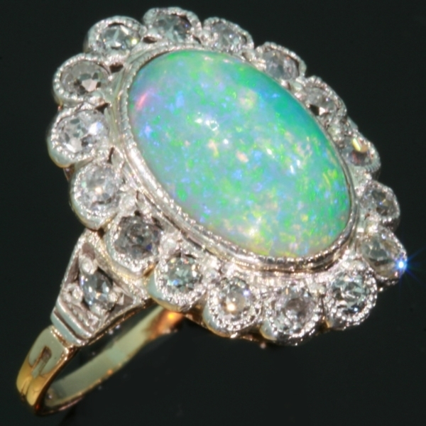 Vintage opal engagement ring diamonds setting by Adin Antique Jewelry
