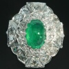 Impressive platinum estate ring with diamonds and cabochon emerald