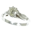 Estate platinum engagement ring with big cushion cut pear shaped diamond