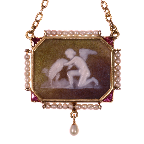 Antique stone cameo pendant on gold chain with mythological motive