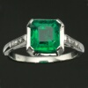 Art Deco platinum engagement ring with stunning emerald