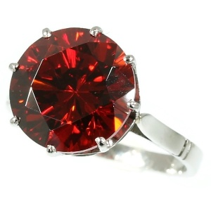 French estate platinum engagement ring with big orangy red stone