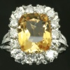 Diamond estate ring with big imperial topaz