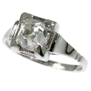 Art Deco engagement ring with high domed cushion cut old mine or peruzzi cut diamond