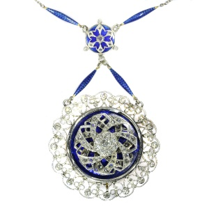 Truly hypnotizing Edwardian mechanical pendant with diamonds and enamel on chain