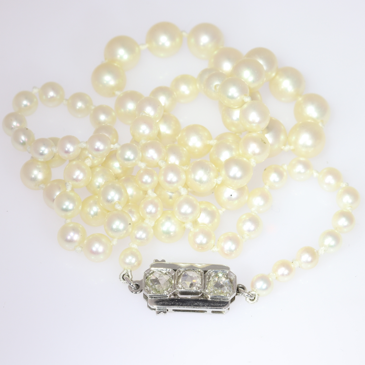 Estate pearl necklace with white gold closure set with rose cut diamonds