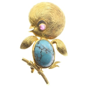 Typical comical comic bird on branch gold brooch from the Fifties