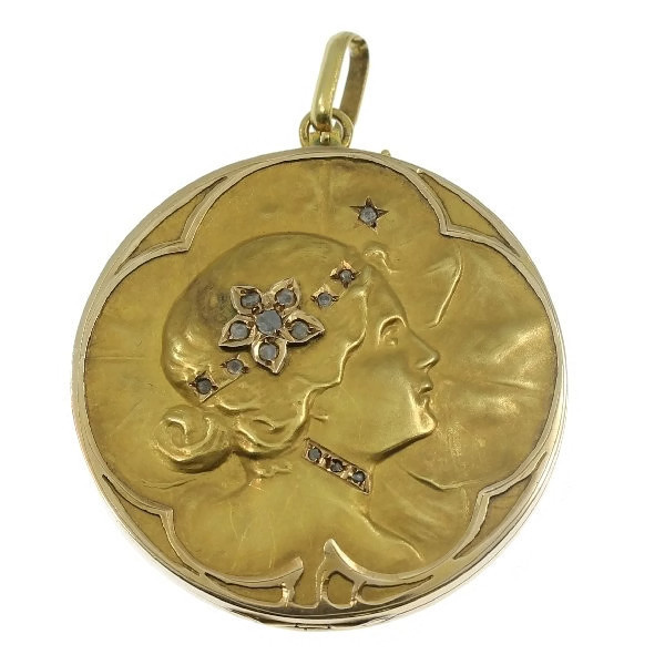 Art Nouveau pendant locket with ladies face and set with rose cut diamonds