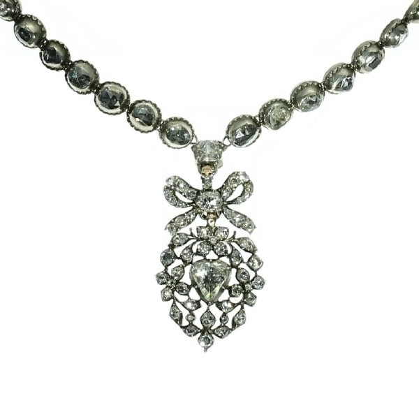 Rose cut diamond riviere necklace with a diamond set crowned heart pendant