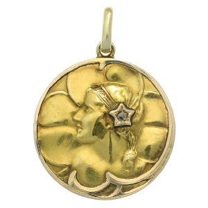 Gold Art Nouveau pendant with rose cut diamond woman head on clover background