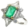 Impressive diamond and emerald engagement ring with big triangle cut diamonds
