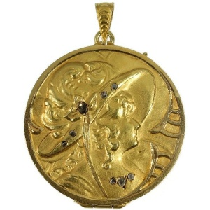 Late Victorian gold locket pendant with rose cut diamonds