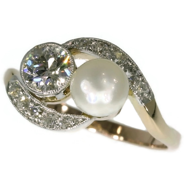 Romantic engagement ring with diamonds and pearl