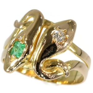 Antique serpent ring with diamond and emerald double headed snake ring