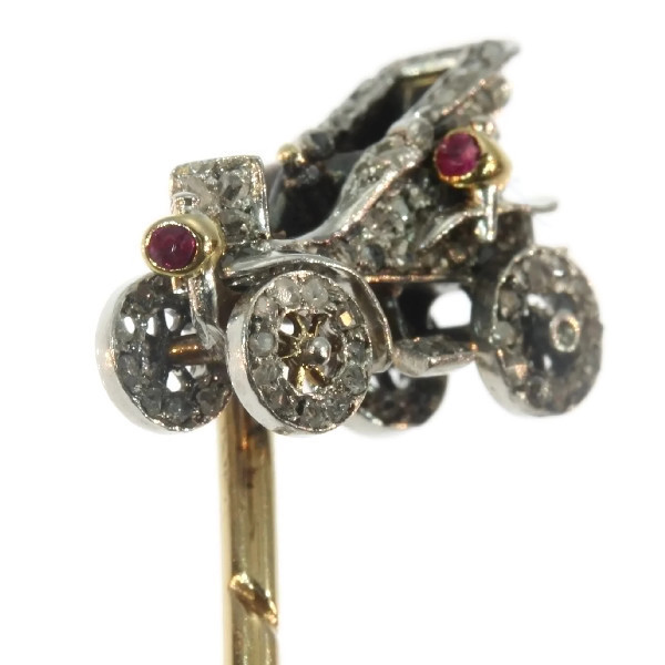 Antique bejeweled tiepin showing one of the first cars
