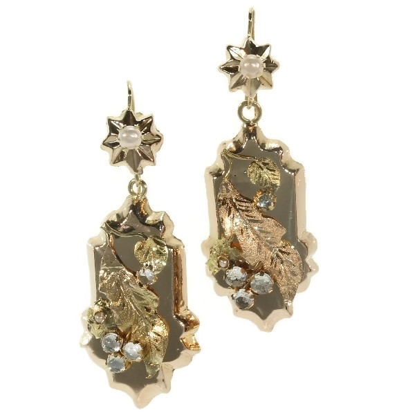 Antique Victorian gold earrings with floral motive