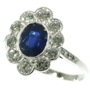 Vintage platinum Lady Di engagement ring with brilliant and sapphire