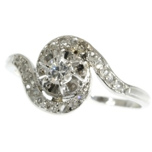Art Deco curled up platinum ring with diamonds
