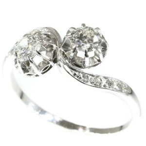Vintage love ring so called toi et moi or cross over ring with diamonds