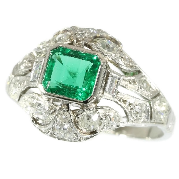 Platinum estate diamond engagement ring with truly magnificent Colombian emerald