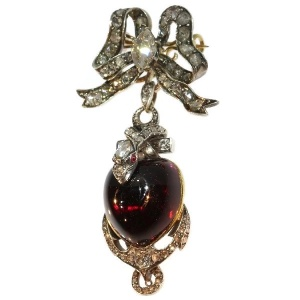 Early-Victorian diamond brooch-pendant medallion large heart shaped garnet cabochon snake anchor and bow