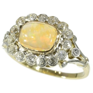 Belle Epoque vintage engagement ring with fire opal and old mine cut diamonds