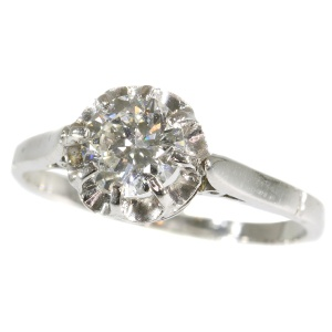 Art Deco platinum diamond solitaire engagement ring (ca. 1920)