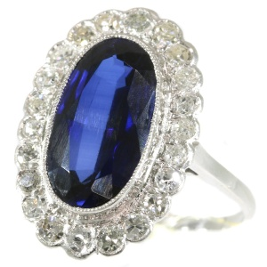Vintage Lady Di engagement ring with big sapphire and diamonds