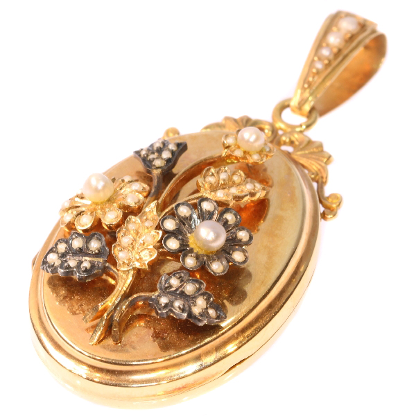 Victorian rose gold locket with seed pearl set bouquet of flowers on top
