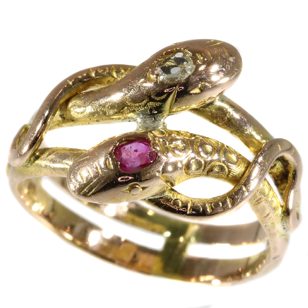 Antique gold double headed snake or serpent ring with ruby and diamond