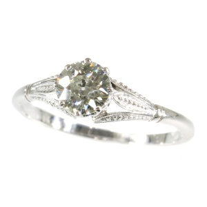 Art Deco engagement ring with little hidden hearts in the sides of the setting