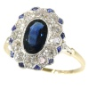 Most elegant diamond and sapphire Lady Di type of engagement ring