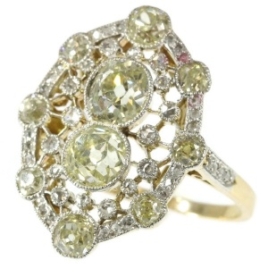 Très Belle Epoque diamond engagement ring with natural fancy color diamonds