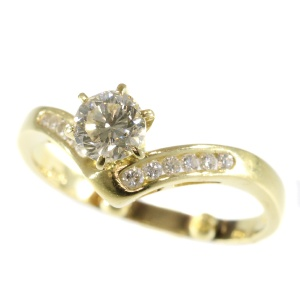 Eye catching engagement ring with 12 diamonds 0.80 ct
