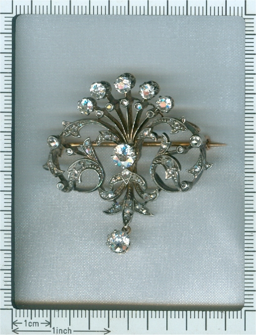 Antique diamond set pendant and brooch in peacock tail model