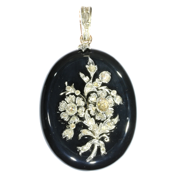 Antique Victorian onyx locket pendant with diamond loaded bouquet on top