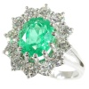 Vintage high quality diamond and vivid green emerald platinum ring with certified emerald