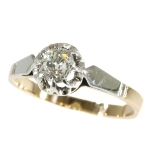 Art Deco bicolour gold solitaire diamond engagement ring (ca. 1930)