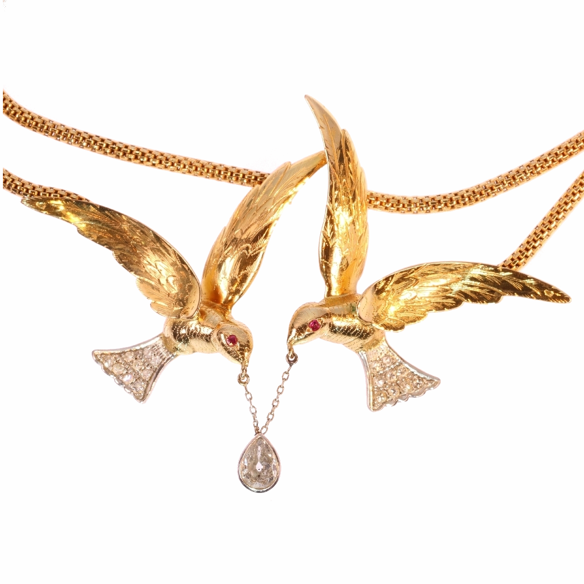 French Fifties necklace with two flying swallows carrying a pear shaped diamond