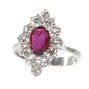 Vintage 1970 s ring with beautiful ruby and set with 12 brilliant cut diamonds