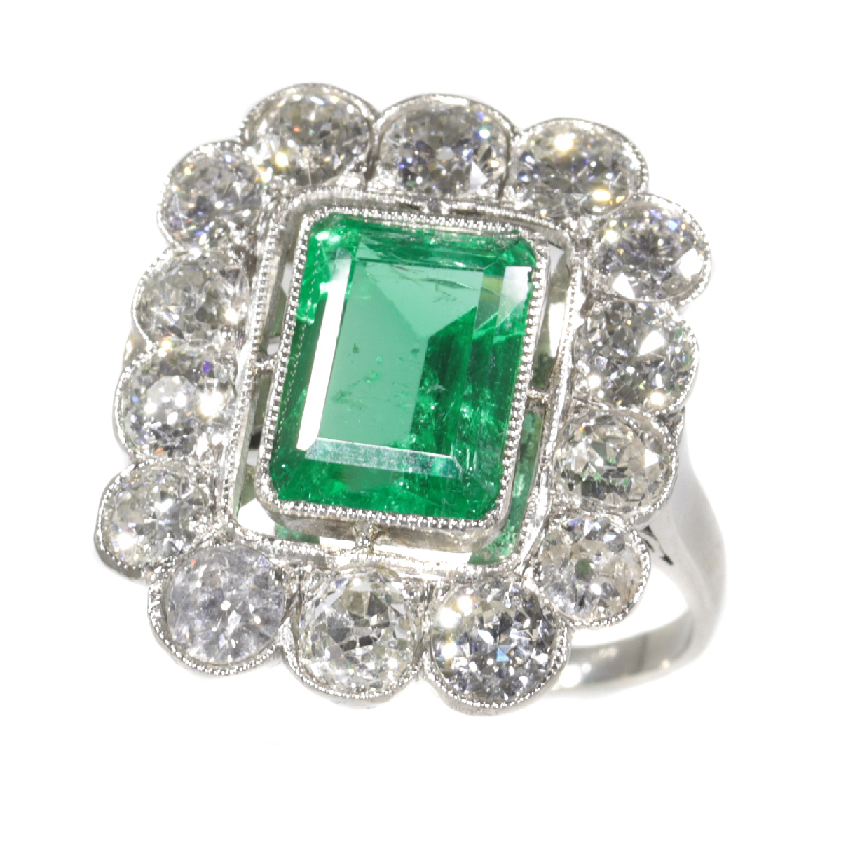 Vintage Fifties platinum diamond ring with untreated natural emerald