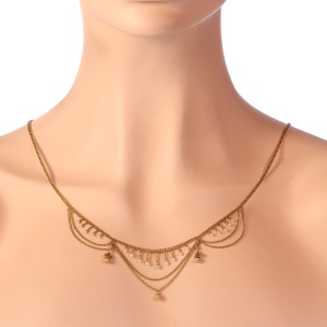 Antique gold bow necklace with natural seed pearls