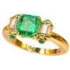 Estate engagement ring with top emerald and diamonds