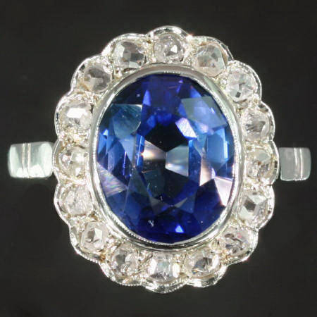 Glamourous sapphire and diamond engagement ring in the lady Di style